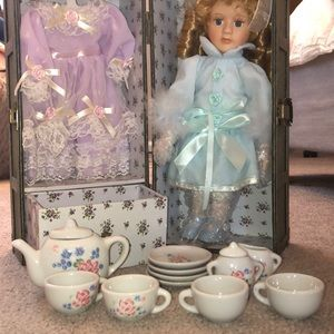 Other - Porcelain doll with 2 outfits and tea set